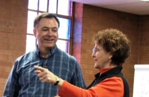Certified World Class Speaking Coach, David Otey, advising a speaker on her presentation